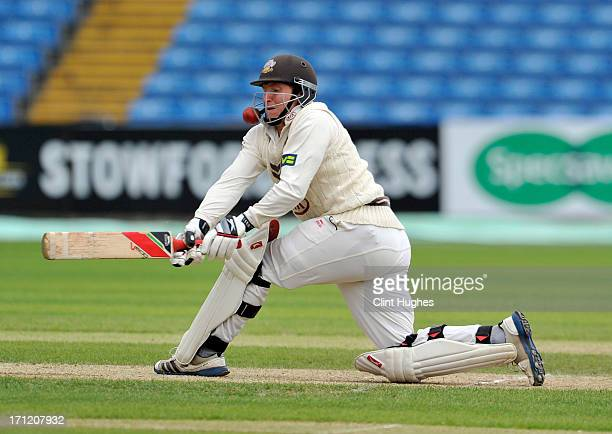 Gary Wilson of Surrey attempts a sweep shot during day three of the LV County Championship Division One match between Yorkshire and Surrey at...