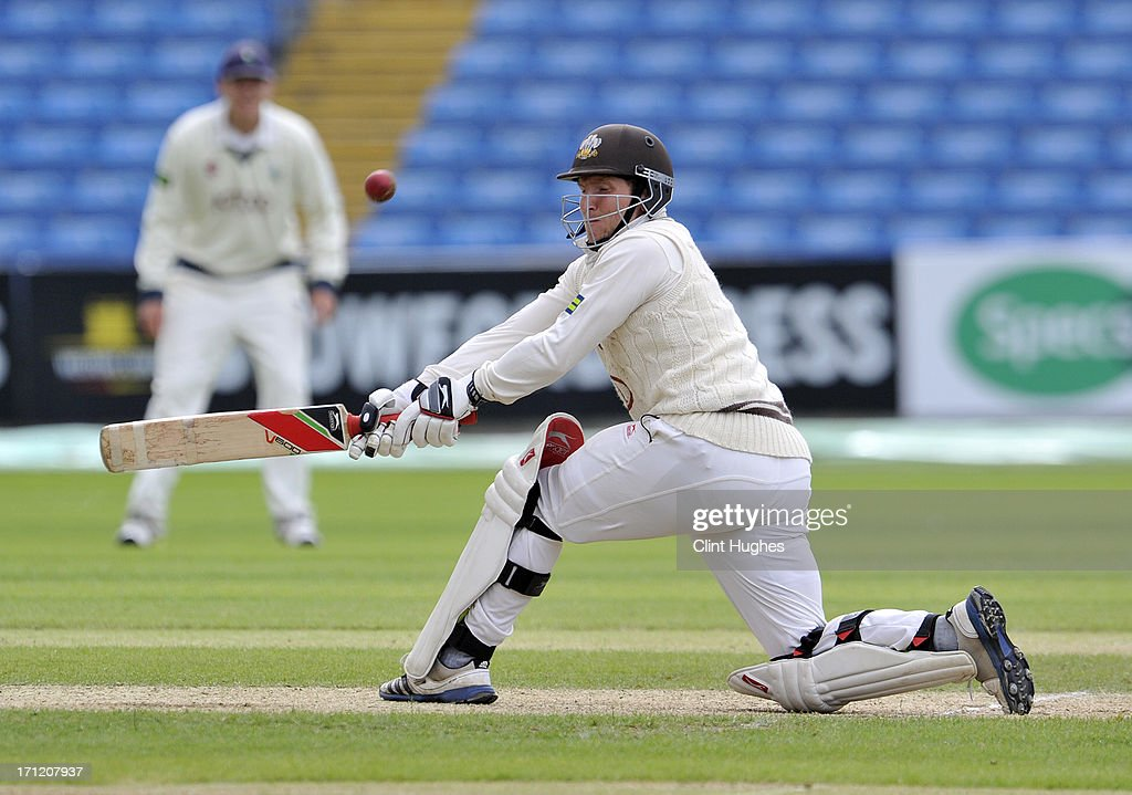 Gary Wilson of Surrey attempts a sweep shot during day three of the LV County Championship Division One match between Yorkshire and Surrey at Headingley on June 23, 2013 in Leeds, England.