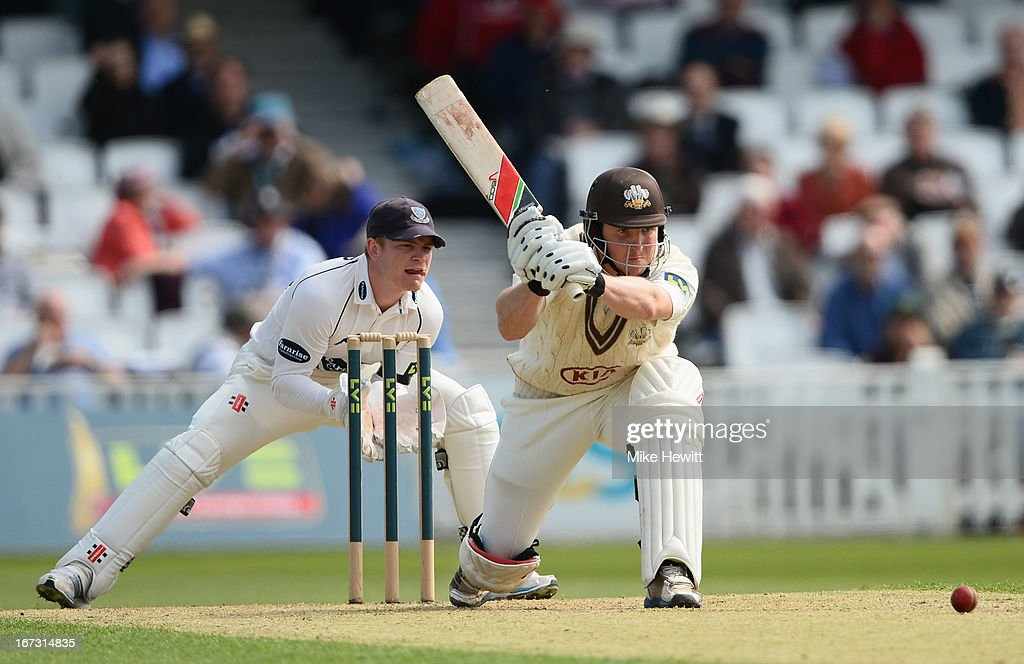 Gary Wilson of Surrey hits out as wicketkeeper Ben Brown looks on during day one of the LV County Championship Division One match between Surrey and Sussex at The Kia Oval on April 24, 2013 in London, England.