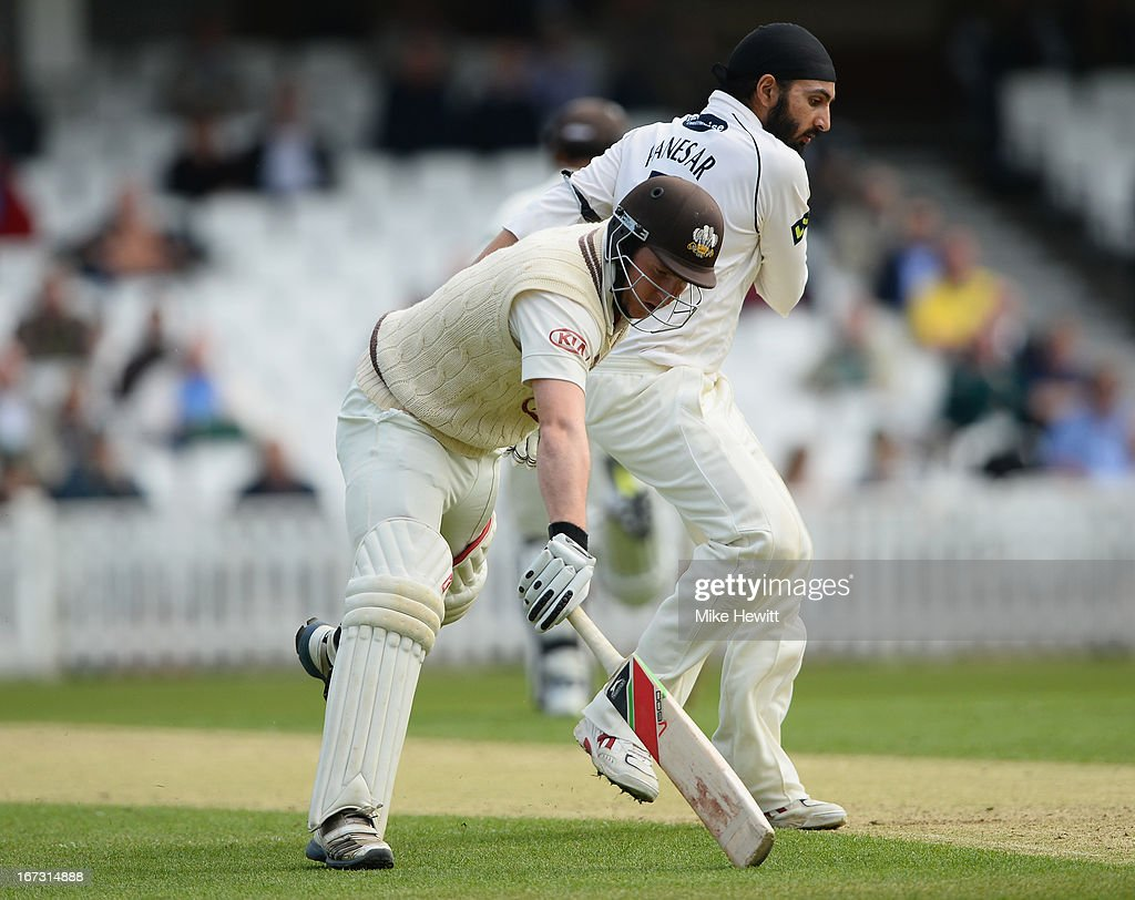 Gary Wilson of Surrey runs into <a gi-track='captionPersonalityLinkClicked' href=/galleries/search?phrase=Monty+Panesar&family=editorial&specificpeople=592881 ng-click='$event.stopPropagation()'>Monty Panesar</a> of Sussex as he takes a quick single during day one of the LV County Championship Division One match between Surrey and Sussex at The Kia Oval on April 24, 2013 in London, England.