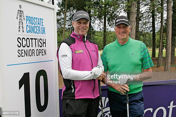 Gary Wolstenholme of England and goalkeeper Ray Clemence on the 10th tee during the first round of the Prostate Cancer UK Scottish Senior Open played...