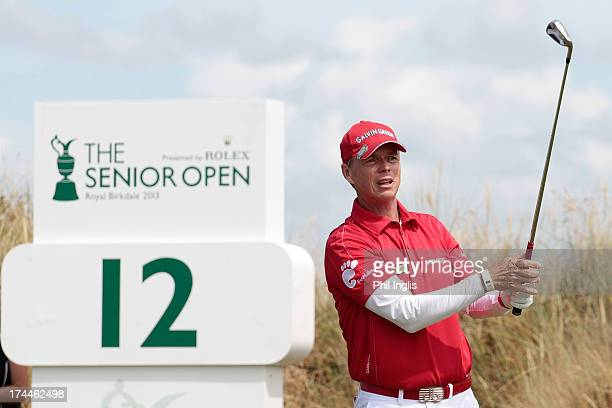 Gary Wolstenholme of England hits a shot from the 12th tee during the second round of The Senior Open Championship played at Royal Birkdale Golf Club...