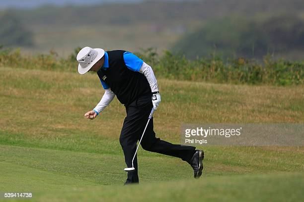 Gary Wolstenholme of England reacts to making a birdie putt on the 17th hole during the final round of the Acorn Jersey Open played at La Moye Golf...