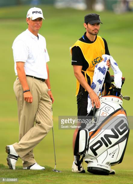 Gary Wolstenholme of England stands on the sixth green with his caddie Andrew Cotter during the second round of the 108th US Open at the Torrey Pines...