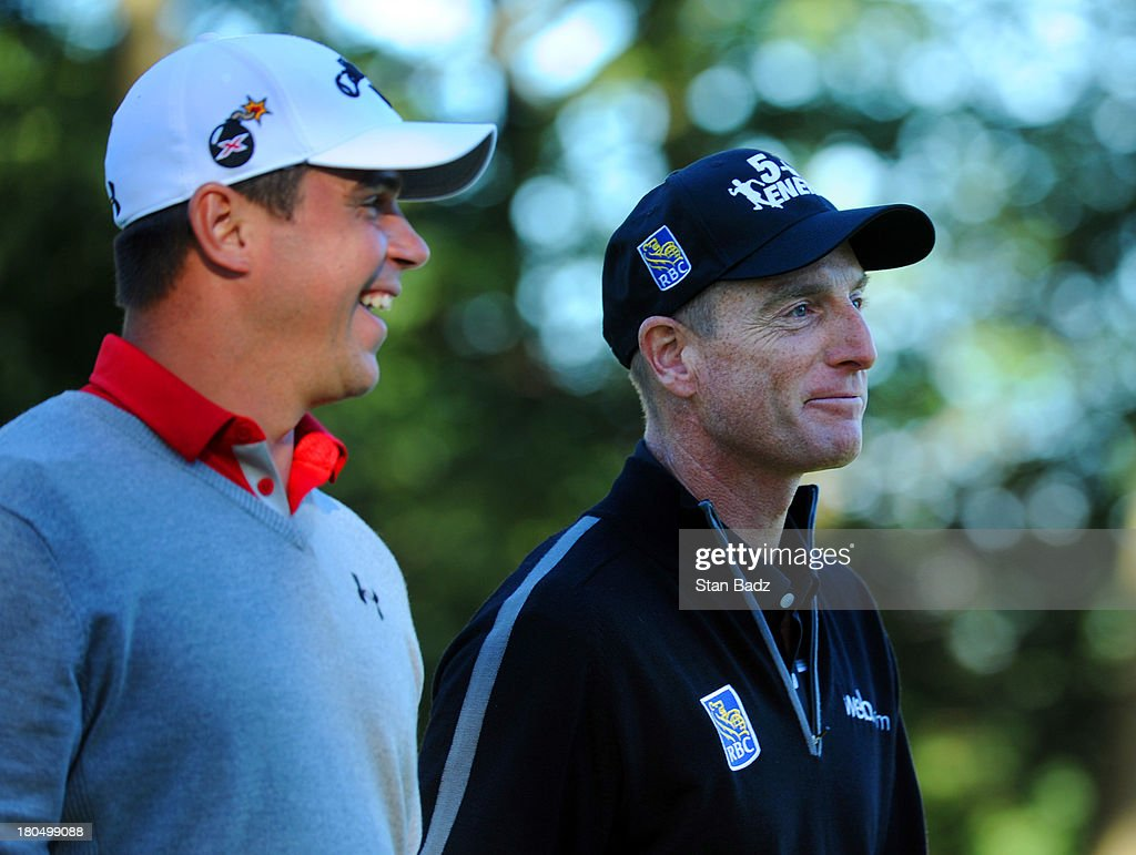 Gary Woodland and Jim Furyk smile after Furyk shot a 59 on the ninth green during the second round of the BMW Championship at Conway Farms Golf Club on September 13, 2013 in Lake Forest, Illinois.