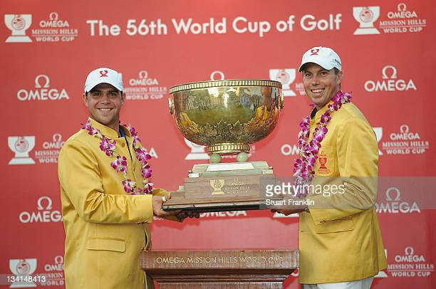 Gary Woodland and Matt Kuchar of USA with the trophy for winning the Omega Mission Hills World Cup at the Mission Hills' Blackstone Course on...