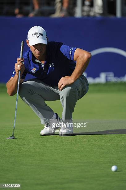 Gary Woodland assesses a putt on the 18th green during the third round of the Farmers Insurance Open on Torrey Pines South on January 25 2014 in La...