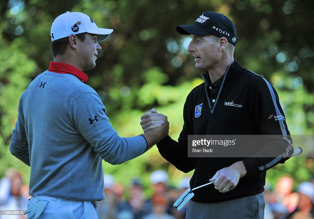 Gary Woodland congratulates Jim Furyk for shooting a 59 on the ninth green during the second round of the BMW Championship at Conway Farms Golf Club on September 13, 2013 in Lake Forest, Illinois.