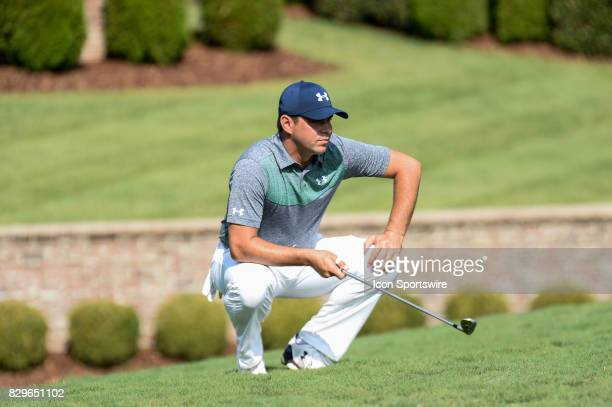 Gary Woodland eyes his chip on the 7th green during 1st round action at the PGA Championship at the Quail Hollow Club on August 10 2017 in Charlotte...