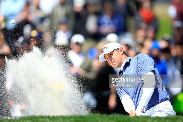Gary Woodland hits his second shot from the bunker on the second hole during his championship match in the World Golf Championships Cadillac Match...