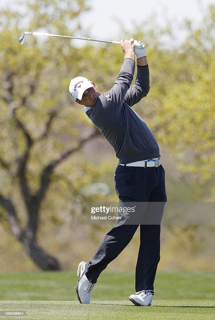 Gary Woodland hits his second shot on the 18th hole during the first round of the Valero Texas Open held at the AT&T Oaks Course at TPC San Antonio on April 4, 2013 in San Antonio, Texas.