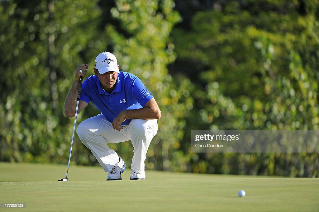 Gary Woodland lines up a birdie putt on the 16th green during the final round of The Barclays at Liberty National Golf Club on August 25, 2013 in Jersey City, New Jersey.