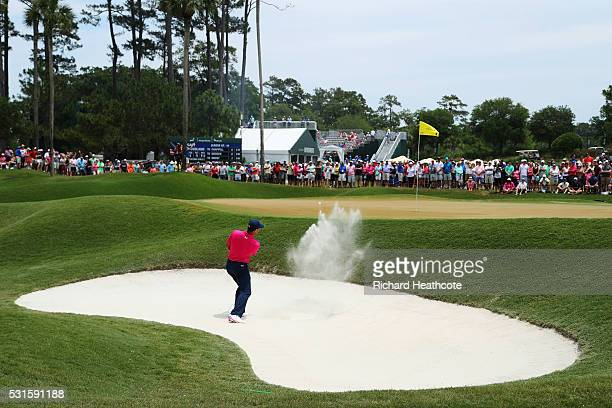 Gary Woodland of the United States plays a shot from a bunker on the second hole during the final round of THE PLAYERS Championship at the Stadium...