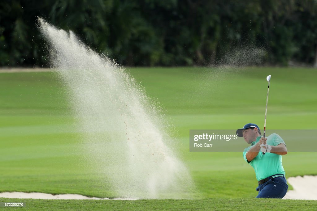 Gary Woodland of the United States plays a shot from a bunker on the 16th hole during the first round of the OHL Classic at Mayakoba on November 9, 2017 in Playa del Carmen, Mexico.