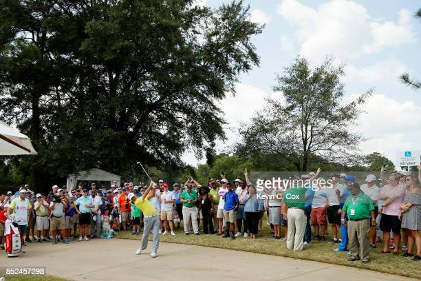 Gary Woodland of the United States plays a shot from a cement path on the first hole during the third round of the TOUR Championship at East Lake...
