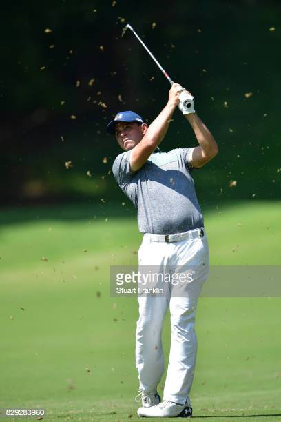 Gary Woodland of the United States plays a shot on the 12th hole during the first round of the 2017 PGA Championship at Quail Hollow Club on August...