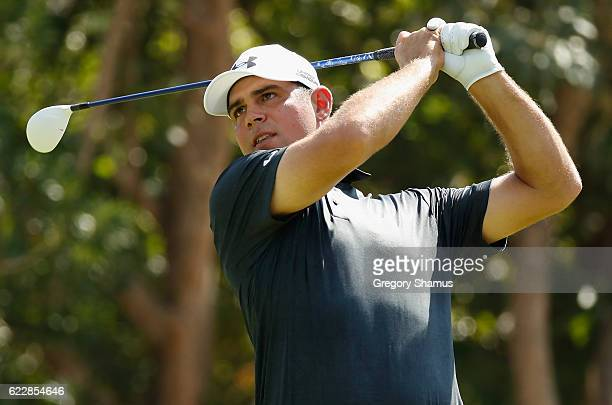 Gary Woodland of the United States plays his shot from the seventh tee during the third round of the OHL Classic at Mayakoba on November 12 2016 in...