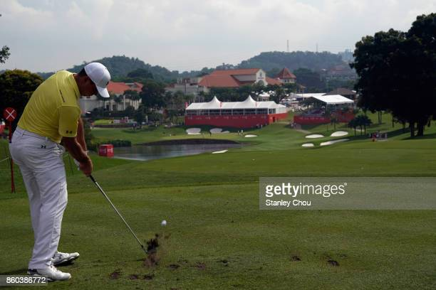 Gary Woodland of the United States plays on the 14th hole during round one of the 2017 CIMB Classic at TPC Kuala Lumpur on October 12 2017 in Kuala...