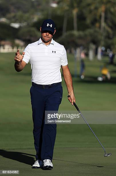 Gary Woodland of the United States reacts after putting for birdie on the 18th green during the second round of the Sony Open In Hawaii at Waialae...