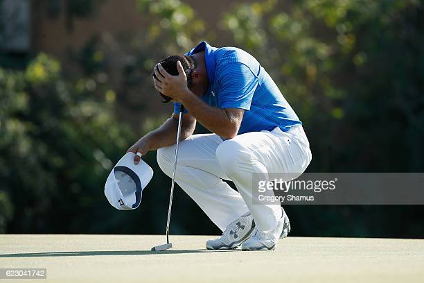 Gary Woodland of the United States reacts to his round prior to putting for par on the 17th green during the final round of the OHL Classic at...