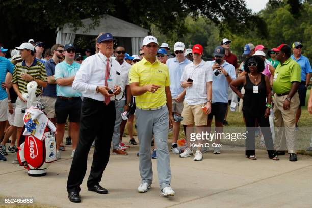 Gary Woodland of the United States speaks ot a rules official on the first hole during the third round of the TOUR Championship at East Lake Golf...