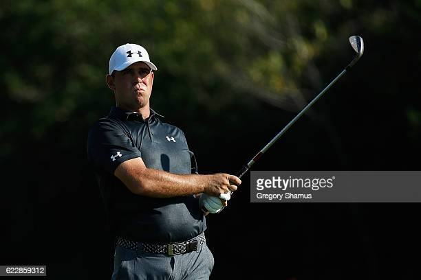 Gary Woodland of the United States watches his shot from the 17th fairway during the third round of the OHL Classic at Mayakoba on November 12 2016...
