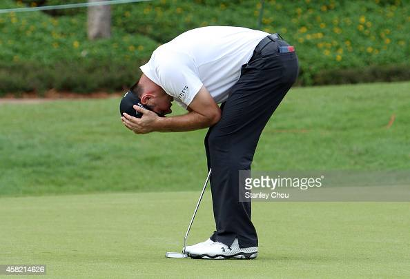 Gary Woodland of United States reacts fater missing a birdie putt on the 17th hole during day three of the 2014 CIMB Classic at Kuala Lumpur Golf...