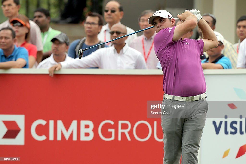 Gary Woodland of USA tees off on the 1st hole during round two of the CIMB Classic at Kuala Lumpur Golf & Country Club on October 25, 2013 in Kuala Lumpur, Malaysia.