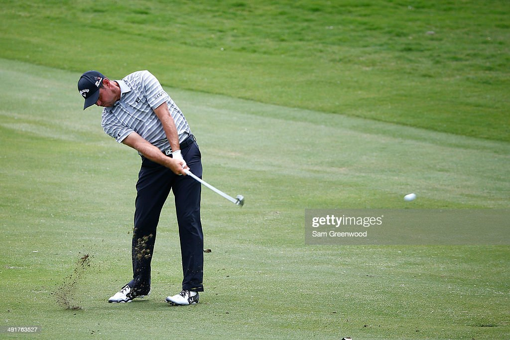 Gary Woodland plays a fairway shot on the sixth hole during the third round of the HP Byron Nelson Championship at the TPC Four Seasons on May 17, 2014 in Irving, Texas.