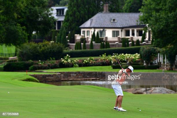 Gary Woodland plays a shot during a practice round prior to the 2017 PGA Championship at Quail Hollow Club on August 7 2017 in Charlotte North...
