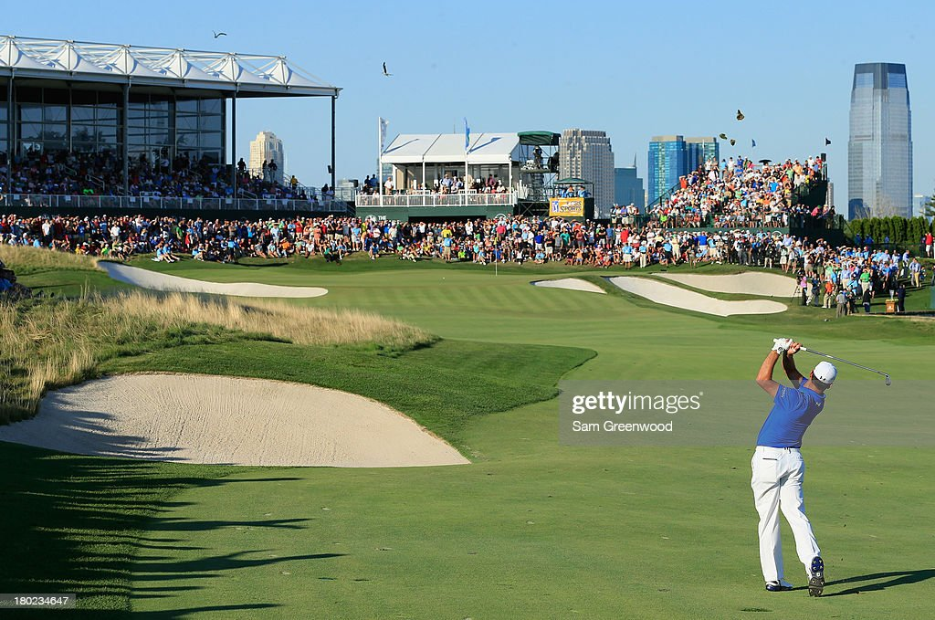 Gary Woodland plays a shot on the 18th hole during the final round of The Barclays at Liberty National Golf Club on August 25 2013 in Jersey City New...