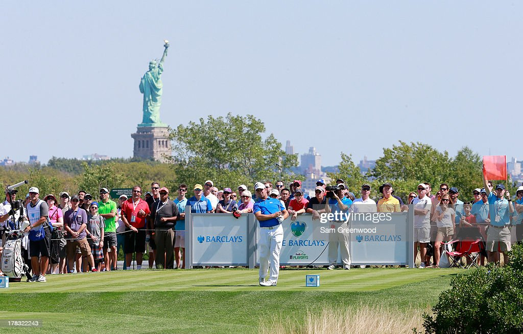 Gary Woodland plays a shot on the third hole during the final round of The Barclays at Liberty National Golf Club on August 25 2013 in Jersey City...