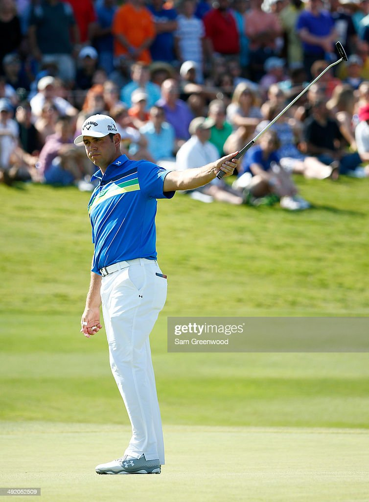 Gary Woodland reacts to a birdie putt on the 18th hole during the final round of the HP Byron Nelson Championship at the TPC Four Seasons on May 18...