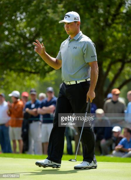 Gary Woodland reacts to his putt on the fourth hole during the second round of the BMW Championship at Cherry Hills Country Club on September 5 2014...