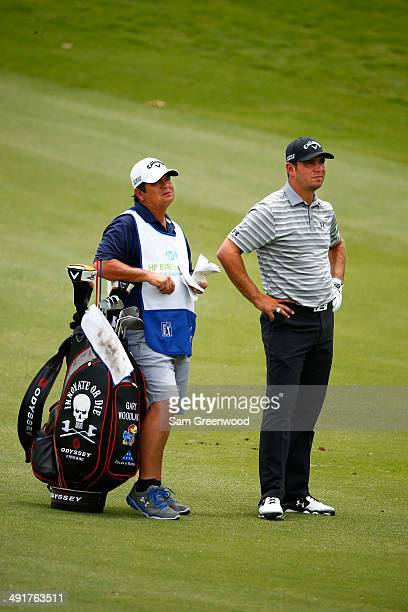 Gary Woodland waits with his caddie Tony Navarro on the sixth hole during the third round of the HP Byron Nelson Championship at the TPC Four Seasons...