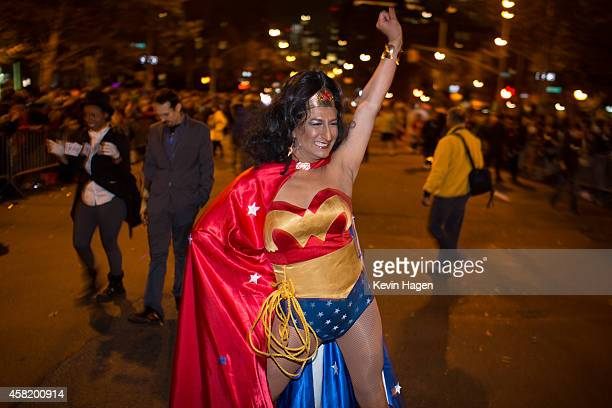 Garza dressed as Wonder Woman walks in the 41st Annual Village Halloween Parade October 31 2014 in New York City Thousands of costumed New Yorkers...