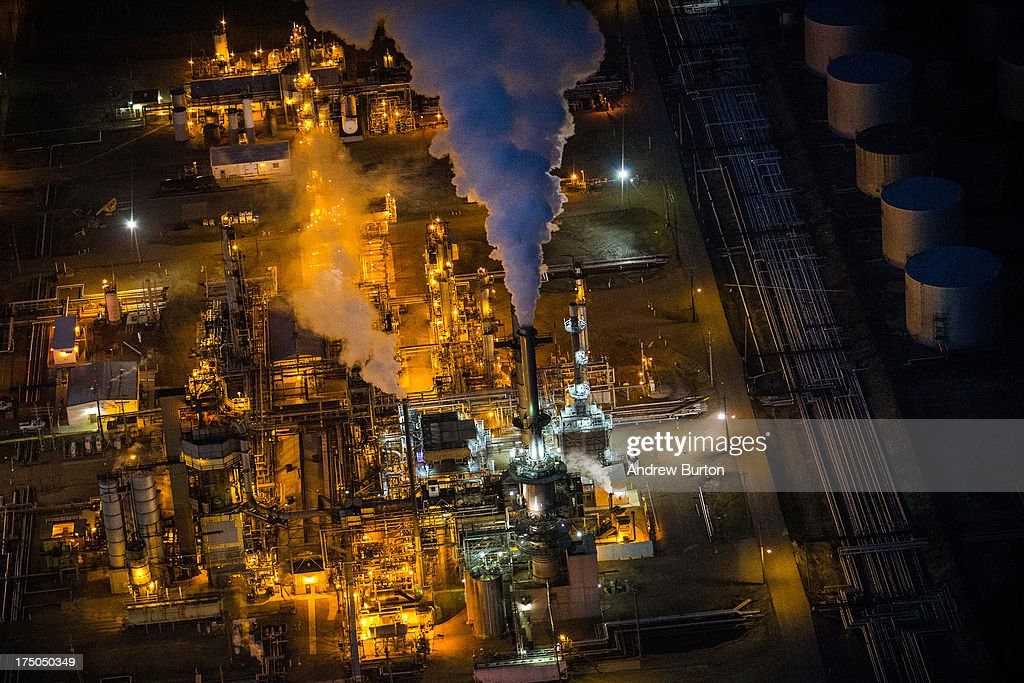 A gas and oil refinery is seen in an aerial view in the early morning hours of July 30, 2013 in Bismarck, North Dakota. The state has seen a boom in oil production thanks to new drilling techniques including horizontal drilling and hydraulic fracturing.