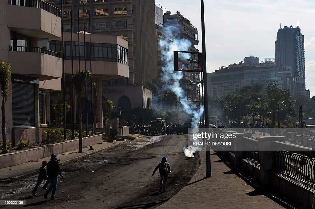 A gas canister is lobbed as Egyptian protesters take part in clashes with riot police near Cairo's Tahrir Square on January 29, 2013. Egypt's military chief warned that the political crisis sweeping the country could lead to the collapse of the state, as thousands defied curfews and the death toll from days of rioting rose to 52. AFP PHOTO / KHALED DESOUKI