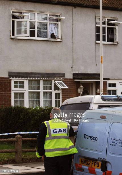 A gas engineer stands outside 98 Alderman Avenue in Barking Essex where three people were found dead from a gas leak