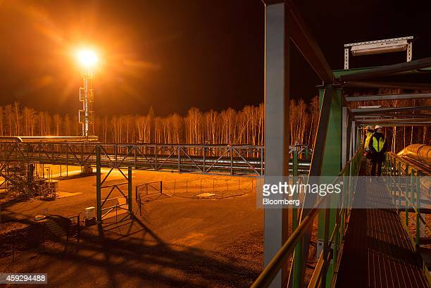 A gas flare illuminates surrounding forest at Eesti Energia AS's Enefit 280 oil shale processing plant and energy production facility as waste gases...