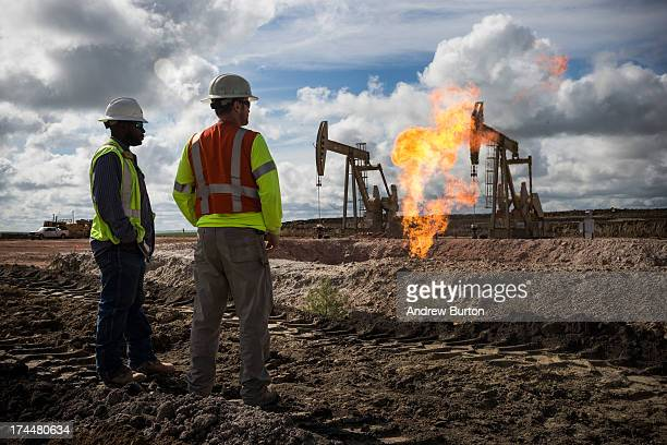 A gas flare is seen at an oil well site on July 26 2013 outside Williston North Dakota Gas flares are created when excess flammable gases are...