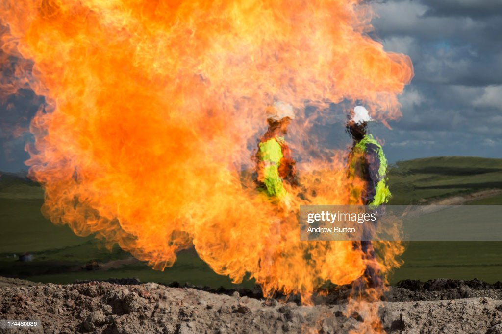 A gas flare is seen at an oil well site on July 26, 2013 outside Williston, North Dakota. Gas flares are created when excess flammable gases are released by pressure release valves during the drilling for oil and natural gas. North Dakota has been experiencing an oil boom recently, bringing tens of thousands of jobs to the region, lowering state unemployment and bringing a surplus to the state budget.