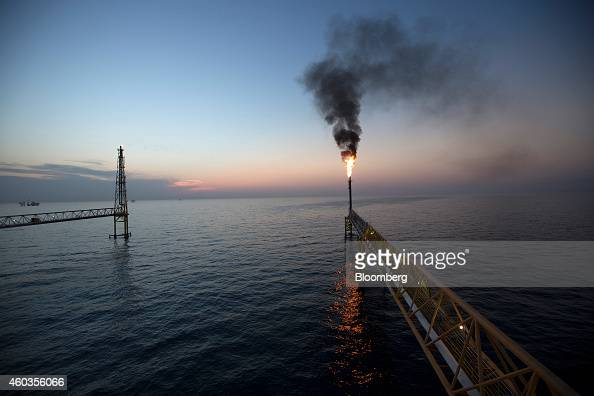 Gas flares from a burner tower on the Petroleos Mexicanos PolA Platform complex located on the continental shelf in the Gulf of Mexico 70 kilometers...
