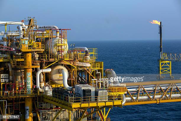 Gas flares from a burner tower right on one of the sections of the Petroleos Mexicanos PolA Platform complex located on the continental shelf in the...