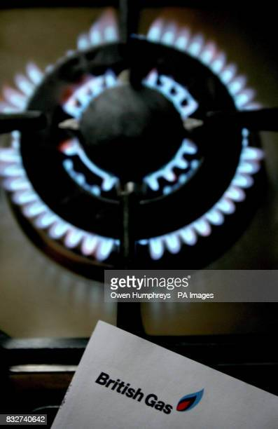 A gas hob with a British Gas bill as British Gas today said it was cutting its gas and electricity prices from next month