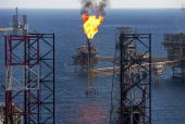 Gas is flared off from a Petroleos Mexicanos offshore platform producing oil from the KuMaloobZaap field in the Gulf of Mexico 65 miles northeast of...