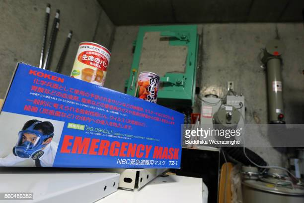 A gas mask box and radiationblocking air purifiers system are seen inside a nuclear shelter on October 12 2017 in Hara Nagano Japan Some people are...