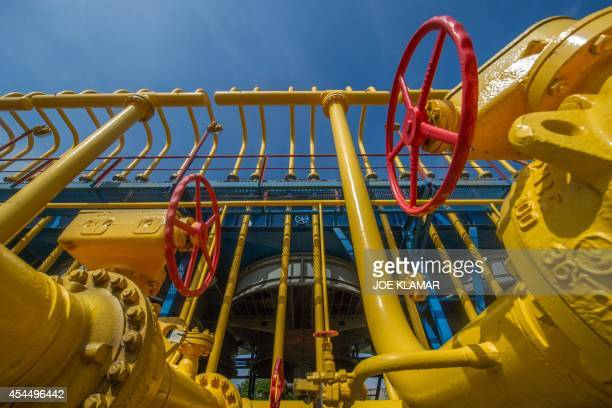 Gas pipes are photographed at the gas compressor station in Velke Kapusany Slovakia on September 2 2014 Slovakia has opened a reverse gas pipeline...