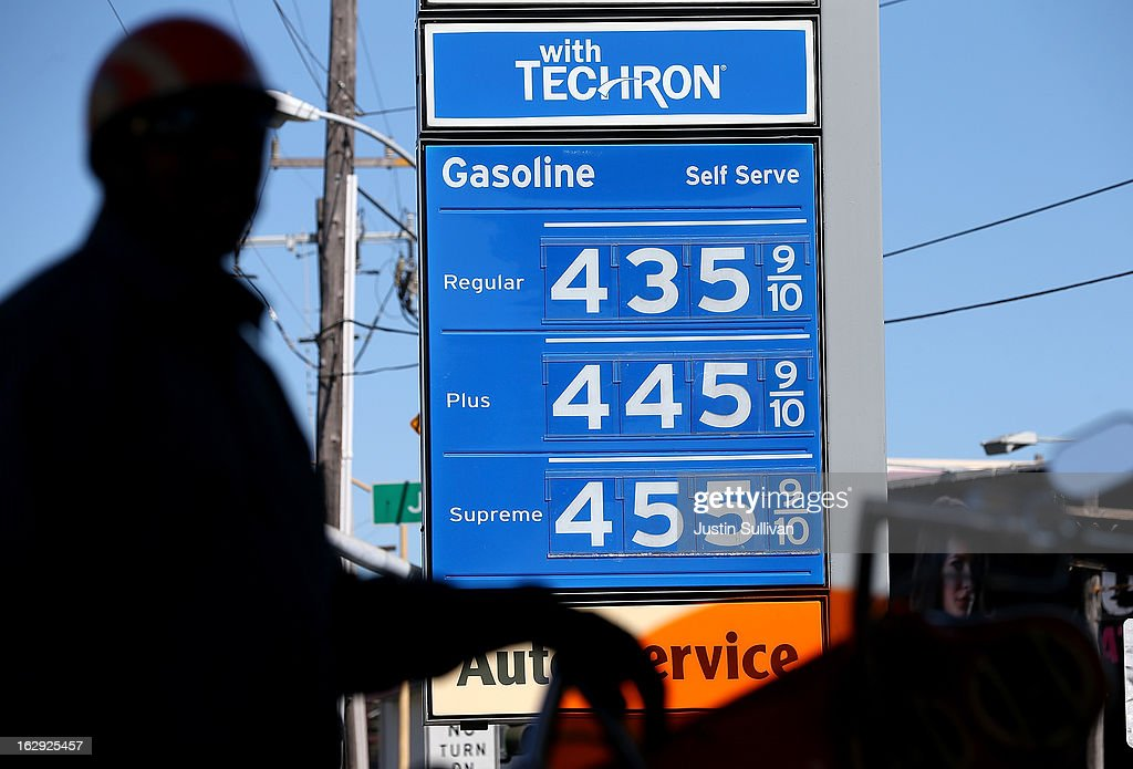 Gas prices are displayed as a motorcyclist pumps gas into his motorcycle at a Chevron gas station on March 1, 2013 in San Francisco, California. The California Board of Equalization voted on Thursday to implement a statewide excise tax on gasoline starting July 1 that will increase the tax by 3.5 cents to 39.5 cents per gallon.