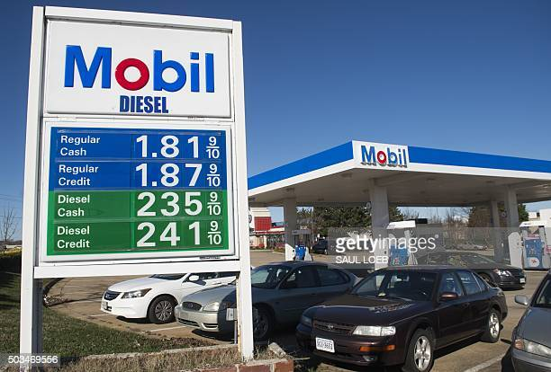 Gas prices are displayed at a Mobil gas station in Woodbridge Virginia January 5 2016 Oil prices fell further January 5 as the crude supply glut...